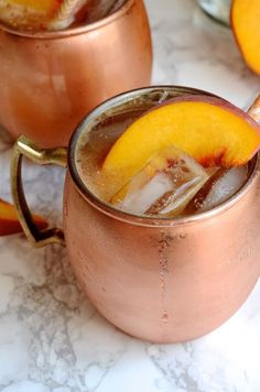 Try this easy Moscow Mule recipe made with fresh peach and ginger puree, vodka, and ginger beer.