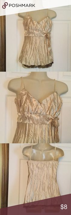 Gold Crinkled Satin Top Gold with brown lace at the bottom and a tie bow at the waist.  Adjustable straps.  Very good condition. Size is torn out, but it is a junior small.  Top has a lining also, both are 100% polyester. Tops Blouses