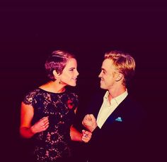 Emma Watson & Tom Felton. I'm SERIOUS! They would be the most attractive couple in the history of the world!
