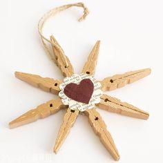 Clothespin snowflake ornaments are a pretty and frugal craft! Spruce them up with paint, paper and leather!