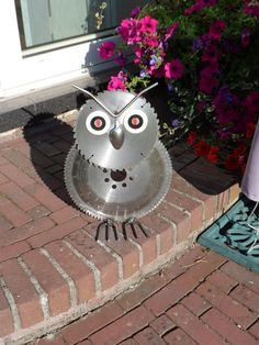 Junk metal Art Owl from cheese grater and metal lids, bottle caps ...