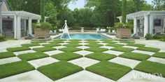 "I can host a Champagne-and-caviar cocktail party for business associates or hamburgers and hot dogs for the kids, and both events will feel comfortable and stylish,"" says Angela Aaron Horowitz of the outdoor kitchen and living spaces that designer Ann Sutherland furnished for her Dallas house.A checkerboard lawn leads to the pool. Chaises in Perennials fabric, Restoration Hardware. Sculpture, Tom Corbin.  - Veranda.com"