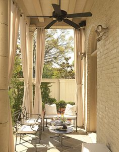 white brick loggia, patio, sky high drapes