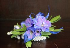 white rose and blue delphinium corsage | Prom Corsages and Boutonnieres - Martin's, the Flower People
