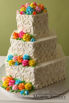 Mini Buttercream Roses #33Classic This hexagon creation is fully decorated with swirls made of buttercream. The colorful buttercream roses really make the cake stand out. Your choice of colors are available.