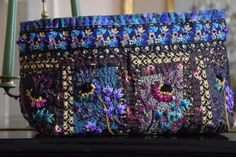 Flowery plum embroidered bag by O core wire on Canal Blog.