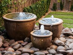 3 garden fountains placed on stones