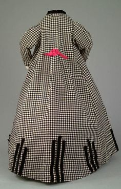 A-line black and white woolen Coat Dress with detailed decoration including applied strips of black velvet ribbon, as well as black velvet collar and