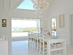 gorgeous. all white everythang. love the open-ness to the outside and the high ceilings and it all.