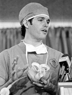 Dr. Robert Jarvik, inventor of the first permanent artificial #heart, Jarvik-7, holds up a model like the one he implanted in Barney Clark in Salt Lake City, Utah, in 1982.  The patient survived for 112 days.