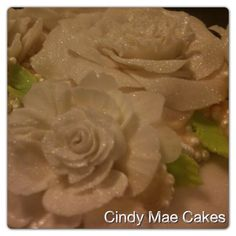 Gumpaste/fondant flower by Cindy Mae Cakes.