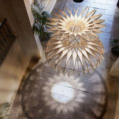 Equal parts light sculpture and lamp, the Dome 90 Chandelier proposes an intricate play of shadow and light.