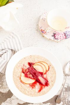 Maple Roasted Rhubarb Buckwheat Porridge Recipe - Ruby hued rhubarb is roasted in maple syrup until soft and luscious and served on a bed of apple buckwheat porridge for a healthy and satisfying way to start your day. | click for the recipe