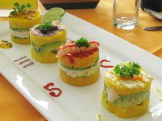This versatile Peruvian potato dish makes a great light meal or a fine addition to a buffet spread. Causa can be layered with any number of fillings.
