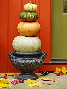 Pumpkin Topiary - A topiary of pumpkins adds a touch of drama to your front entrance. Look for pumpkins in different sizes and colors, then rest the largest pumpkin on a planter. Use wooden skewers to secure each smaller pumpkin to the next, and place near your front door.