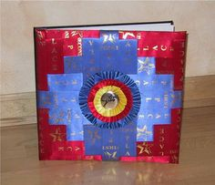 Photo album/scrap book covered with horse show ribbons, very clever.