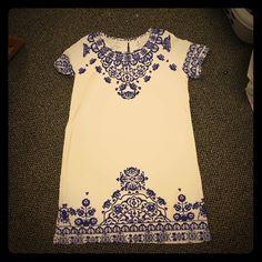 Printed dress White tshirt dress with blue print. Button back keyhole closure. Size M. Never worn Dresses Mini