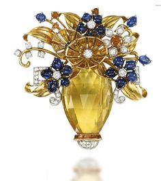 A RETRO GEM-SET CLIP BROOCH Designed as a faceted citrine vase with circular-cut diamond accents to the flowers, each mounted with a variation of cabochon sapphires, citrine and diamonds interspersed with sculpted polished leaves and gem-set foliage, circa 1950. (=)