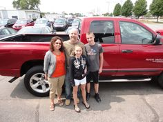"Mark and Jamie Sanborn ""Pictured with their children Nick and Katie"" and their SHARP new Dodge Ram 1500 4X4! Thanks from The Auto Group we hope you enjoy your new truck!"