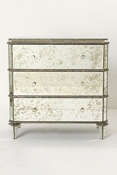 Anthropologie mirrored furniture is my all time favorite ...I love the vintage yet elegant look!