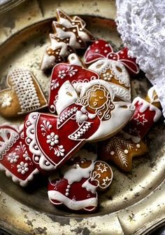 Christmas angels in red and white; decorated cookies with very fine piping.: