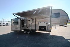 ADVENTURE AWAITS YOU IN THIS RV!!!  2015 Forest River Rockwood Signature Ultra Lite 8282WS Maneuvering this 31' long, 7944 lb. rig is easier than ever with rear camera prep and a molded mounting plate! You'll feel right at home with the lovely vaulted ceilings, decorative backsplash and stone cast sink. The heated and enclosed holding tanks are electronically controlled for optimal use!  Give our Rockwood Signature Ultra Lite expert Kim Thurgood a call 435-315-2154 for pricing.