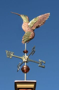 Anna's Hummingbird Weather Vane Flying by West Coast Weather Vanes.  The Anna's Hummingbird Weathervane was made with copper and brass.