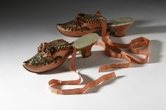 High heel silk boudoir slippers, c. 1880, from the Fashion Victims exhibit - Bata Shoe Museum