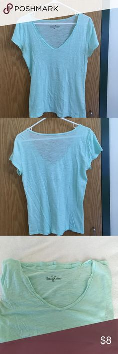 Vineyard Vines V-Neck T-Shirt Lovingly worn. This is your classic summer t-shirt. Please note that it is not blue as the cover photo shoes, but rather a sea green. For some reason my phone camera only picked up the blue. Photos 3-5 show the true color better. Please note that there is a hole under the arm but it shouldn't show when worn because your arm will cover it. 100% Pima Cotton. Vineyard Vines Tops Tees - Short Sleeve