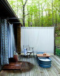Outdoor bath with a fee trough