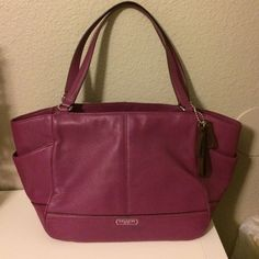 """Coach Park Genuine Leather Carrie Handbag Beautiful soft pebble leather bag with silver tone hardware. Nice bright purple color. Lined interior with zippered pocket and 2 open slip pockets. 3/4 zippered top pocket with open gusset slip pockets on sides. 8.5"""" strap drop Most accurate color in first picture. Only used twice! Coach Bags Shoulder Bags"""