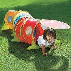 """Wiggle Tunnel by One Step Ahead. $59.95. More wiggles and extra giggles - it's the play tunnel with personality! Our irresistible pop-up kids tunnel has a happy face door that inspires kids to crawl in, out, and around. 78 3/4""""L, with mesh, peek-a-boo windows. Set up intriguing zigzag configurations! Even more fun: it connects to our ball pit and pop-up plays tents! Storage bag included. For ages 3 and up. Imported. Designed by OneStepAhead! Encourages active and imaginati..."""