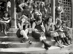 1920's suffragettes, eating pizza in bathing suit because it annoyed the haters. I swear the one in the middle looks like a taller version of me (minus the pizza on her face).