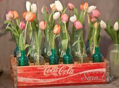 Fresh tulips in old bottles and Coke crate <3 Schoolhouse Country Gardens