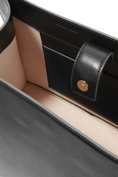 Black leather (Calf) Snap-fastening tab at open top  Comes with dust bag Weighs approximately 4lbs/ 1.8kg Imported