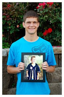 Last day of school holding a picture from the first day of school...  Good idea!