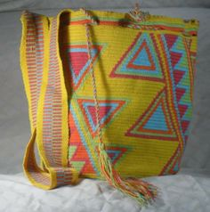 $113 US Dollars or 83 Euros. Includes International Shipping. Each wayuu bag (mochila) takes 4 days to be knitted. Whatsapp +57 3154833188. Pin: 7a85e20e. Catalog in: www.artemalu.com Tapestry Crochet Patterns, Reusable Tote Bags, Crafts, Backpack Purse, Bags, Crocheting, Tejidos, Manualidades, Handmade Crafts