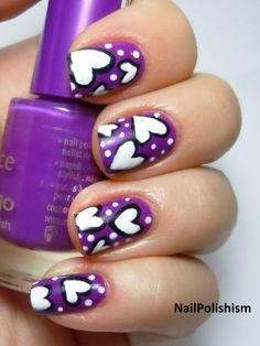 Purple nails with white hearts and polka dots. A perfect look for Valentine's Day! #nailart ♥♥♥♥ ❤ ❥❤ ❥❤ ❥♥♥♥♥