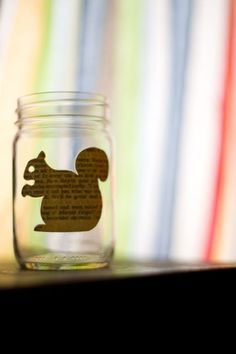 Looks like a mason jar and a picture cut from newspaper and stuck on with mod podge - cute!