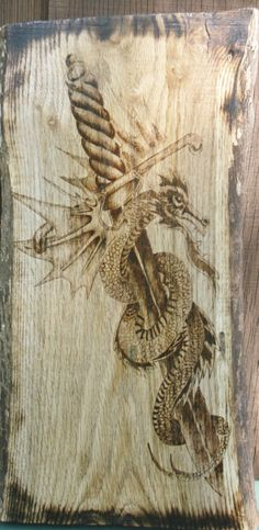 Dragon protects the Sword Wood burning by hippiescreations on Etsy, $70.00