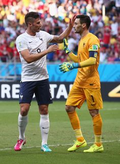 Olivier Giroud Photos Photos - Olivier Giroud of France reacts with his goalkeeper Hugo Lloris during the 2014 FIFA World Cup Brazil Group E match between Switzerland and France at Arena Fonte Nova on June 20, 2014 in Salvador, Brazil. - Switzerland v France: Group E