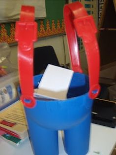 When a student is caught doing something good/positive, they recieve a Smarty Pants ticket. They write their name on it and put it in the bucket.  A certain number are drawn at the end of the week for a prize.