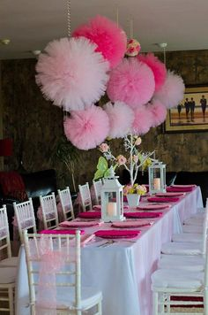 Pink wedding reception decor with ombre pom poms