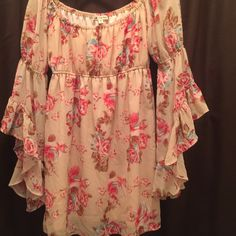 Gorgeous peach color,flower dress Like new, very flattering dress,has a stretchy band. Peach color, sexy sleeves! Dresses Mini