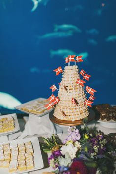 James & Ayn's wedding by Miele Events. Danish cake in the South Carolina Aquarium's Great Hall. Photography by Hyer Images.