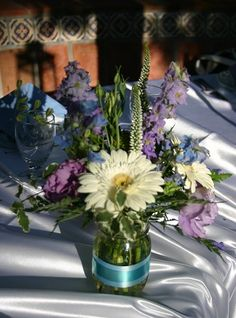 Pretty!! I would switch out the roses for carnations for cost sake.  Found on Weddingbee.com