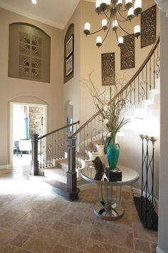 Two story foyer decorating ideas village builders model home i love the s stair railings find this pin and more on 2 story foyer ideas Foyer Decorating, Tuscan Decorating, Interior Decorating, Interior Design, Decorating Blogs, Foyer Staircase, Curved Staircase, Art Niche, Niche Decor