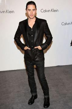 Taken in 2009 at the Calvin Klein show, Jared Leto (love him), wears a suit that has the common fit of the late 2000's. Suits in the 90's were loosely fitted, while the 2000's featured silhouettes with close fits. This emphasizes a clean cut, athletic, and matured look among men in the business world, but still carries a casual look.