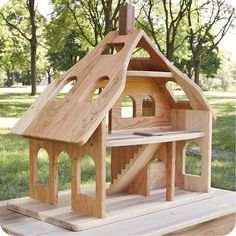 Plenty of natural light enters the large three story wooden dollhouse through its doors, windows and six skylights. Features include a central stairway, arched windows and a removable walnut wood chimney. The Dollhouse by Camden Rose is crafted from solid cherry and maple hardwood and is designed for generations of fun. Optional dollhouse accessories include: The Cherry Dollhouse may be more accessible if placed on a Child's Maple and Cherry Play Table,
