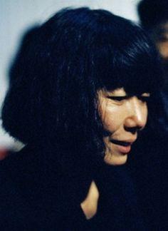 Rei Kawakubo's smile photographed by Ferdinando Scianna, 1987.